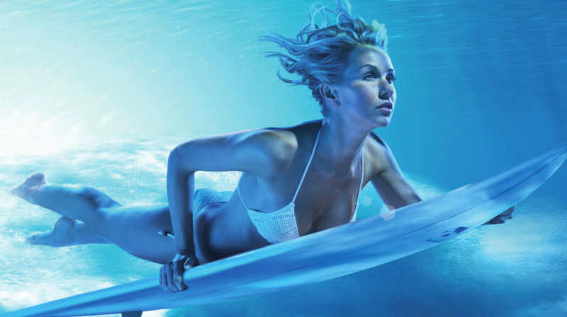 woman on surfboard